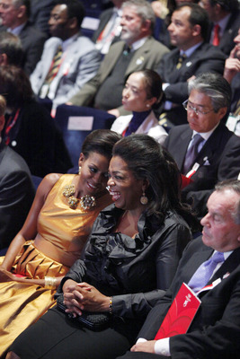 COPENHAGEN, DENMARK - OCTOBER 1:  U.S. first lady Michelle Obama sits with television talk show host Oprah Winfrey, second right, and Chicago Mayor Richard M. Daley, right, at the opening Ceremony of the 121st IOC Session at the Copenhagen Opera House on