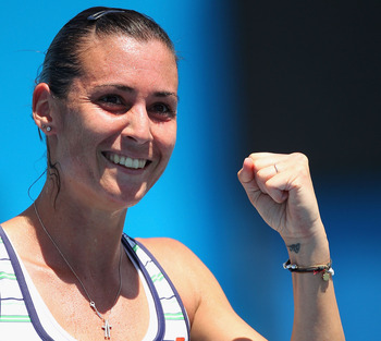MELBOURNE, AUSTRALIA - JANUARY 20:  Flavia Pennetta of Italy celebrates in her second round match against Lourdes Dominguez Lino of Spain during day four of the 2011 Australian Open at Melbourne Park on January 20, 2011 in Melbourne, Australia.  (Photo by