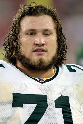 GLENDALE, AZ - JANUARY 03:  Josh Sitton #71 of the Green Bay Packers looks on from the sideline against the Arizona Cardinals at University of Phoenix Stadium on January 3, 2010 in Glendale, Arizona.  (Photo by Jamie Squire/Getty Images)