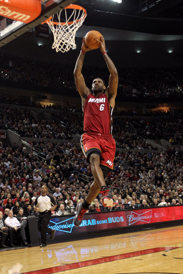 PORTLAND, OR - JANUARY 09: LeBron James #6 of the Miami Heat dunks against the Portland Trail Blazers during a game on January 9, 2011 at the Rose Garden Arena in Portland, Oregon. NOTE TO USER: User expressly acknowledges and agrees that, by downloading