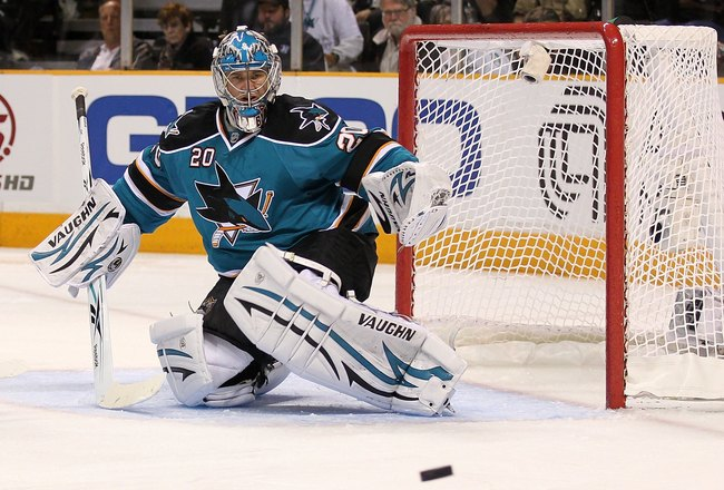 SAN JOSE, CA - MAY 18:  Goaltender Evgeni Nabokov #20 of the San Jose Sharks looks at the puck while taking on the Chicago Blackhawks in Game Two of the Western Conference Finals during the 2010 NHL Stanley Cup Playoffs at HP Pavilion on May 18, 2010 in S