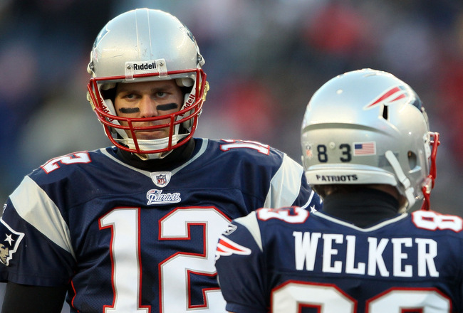 FOXBORO, MA - JANUARY 16:  Tom Brady #12 and Wes Welker #83 of the New England Patriots look on during their 2011 AFC divisional playoff game against the New York Jets at Gillette Stadium on January 16, 2011 in Foxboro, Massachusetts.  (Photo by Elsa/Gett