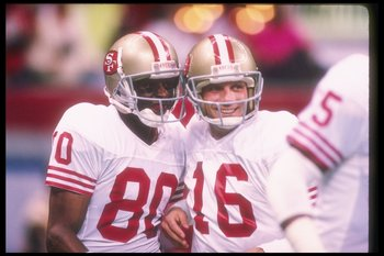 28 Jan 1990:  San Francisco 49ers quarterback Joe Montana (right) and wide receiver Jerry Rice celebrate during Super Bowl XXIV against the Denver Broncos at the Superdome in New Orleans, Louisiana.  The 49ers won the game, 55-10. Mandatory Credit: Rick S
