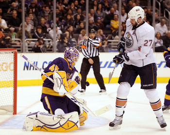 LOS ANGELES, CA - JANUARY 15:  Jonathan Bernier #45 of the Los Angeles Kings makes a save as Dustin Penner #27 of the Edmonton Oilers waits for a rebound during a 5-2 Kings win at the Staples Center on January 15, 2011 in Los Angeles, California.  (Photo