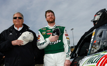 ATLANTA - MARCH 07:  Team owner Rick Hendrick (L) stands with Dale Earnhardt Jr. (R), beside the #88 AMP Energy/National Guard Chevrolet prior to the start of the NASCAR Sprint Cup Series Kobalt Tools 500 at Atlanta Motor Speedway on March 7, 2010 in Hamp
