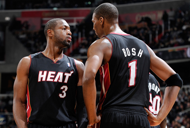 WASHINGTON, DC - DECEMBER 18:  Dwyane Wade #3 of the Miami Heat talks with Chris Bosh #1 during the game against the Washington Wizards at the Verizon Center on December 18, 2010 in Washington, DC. NOTE TO USER: User expressly acknowledges and agrees that