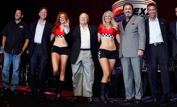 DALLAS - AUGUST 17:  (L-R) Tony Stewart, driver of the #14 Office Depot/Old Spice Chevrolet, NASCAR chairman Brian France, Speedway Motorsports Inc. owner/CEO, Bruton Smith, Texas Motor Speedway president Eddie Gossage, Indy Racing League CEO Randy Bernar