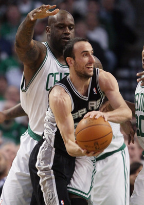 BOSTON, MA - JANUARY 05:  Manu Ginobili #20 of the San Antonio Spurs tries to pass as Shaquille O'Neal #36 of the Boston Celtics defends on January 5, 2011 at the TD Garden in Boston, Massachusetts. NOTE TO USER: User expressly acknowledges and agrees tha