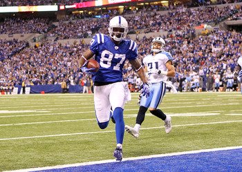INDIANAPOLIS - JANUARY 02:  Reggie Wayne #87 of the Indianapolis Colts runs for a touchdown during NFL game against the Tennessee Titans at Lucas Oil Stadium on January 2, 2011 in Indianapolis, Indiana.  (Photo by Andy Lyons/Getty Images)
