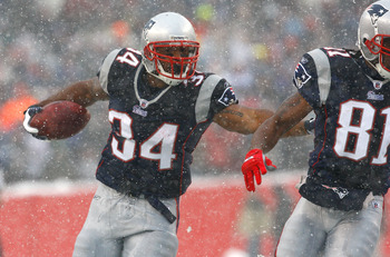 FOXBORO, MA - DECEMBER 21: Randy Moss #81 blocks for teammate Sammy Morris #34 of the New England Patriot against the Arizona Cardinals at Gillette Stadium on December 21, 2008 in Foxboro, Massachusetts. The Patriots won 47-7. (Photo by Jim Rogash/Getty I