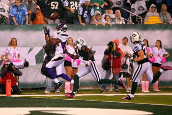 EAST RUTHERFORD, NJ - OCTOBER 11:  Randy Moss #84 of the Minnesota Vikings catches a 37-yard touchdown pass in the third quarter against Antonio Cromartie #31 and Jim Leonhard #36 of the New York Jets at New Meadowlands Stadium on October 11, 2010 in East
