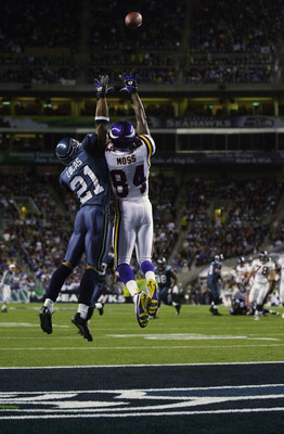 SEATTLE - SEPTEMBER 29:  Randy Moss #84 of the Minnesota Vikings leaps for the ball against Ken Lucas #21 of the Seattle Seahawks during the game on September 29, 2002 at Seahawks Stadium in Seattle, Washington.  The ball was batted away by Chavous.  The