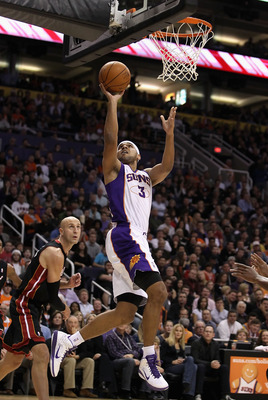 PHOENIX - DECEMBER 23:  Jared Dudley #3 of the Phoenix Suns puts up a shot against the Miami Heat during the NBA game at US Airways Center on December 23, 2010 in Phoenix, Arizona. The Heat defeated the Suns 95-83. NOTE TO USER: User expressly acknowledge