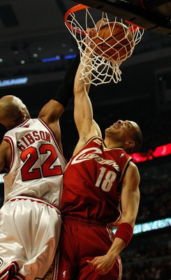 CHICAGO - APRIL 25: Anthony Parker #18 of the Cleveland Cavaliers dunks the ball against Taj Gibson #22 of the Chicago Bulls in Game Four of the Eastern Conference Quarterfinals during the 2010 NBA Playoffs at the United Center on April 25, 2010 in Chicag