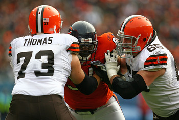 CHICAGO - NOVEMBER 01: Tommie Harris #91 of the Chicago Bears is double-teamed blocked by Joe Thomas #73 and Eric Steinbach #65 of the Cleveland Browns at Soldier Field on November 1, 2009 in Chicago, Illinois. The Bears defeated the Browns 30-6. (Photo b