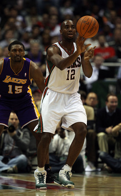 MILWAUKEE - NOVEMBER 16: Luc Richard Mbah a Moute #12 of the Milwaukee Bucks passes the ball in front of Ron Artest #15 of the Los Angeles Lakers at the Bradley Center on November 16, 2010 in Milwaukee, Wisconsin. The Lakers defeated the Bucks 118-107. NO