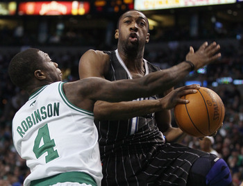 BOSTON, MA - JANUARY 17:   Gilbert Arenas #1 of the Orlando Magic heads for the basket as Nate Robinson #4 of the Boston Celtics defends on January 17, 2011 at the TD Garden in Boston, Massachusetts. The Celtics defeated the Magic 109-106.  NOTE TO USER: