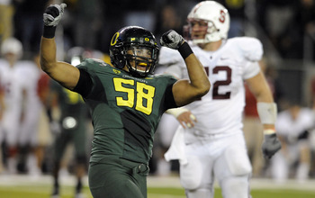 EUGENE, OR - OCTOBER 2: Defensive end Kenny Rowe #58 of the Oregon Ducks celebrates after sacking quarterback Andrew Luck of the Stanford Cardinal in the third quarter of the game at Autzen Stadium on October 2, 2010 in Eugene, Oregon. Oregon won the game