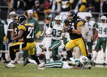 PITTSBURGH - DECEMBER 12:  Strong safety Troy Polamalu #43 of the Pittsburgh Steelers runs with the ball after intercepting a New York Jets pass on December 12, 2004 at Heinz Field in Pittsburgh, Pennsylvania. The Steelers won 17-7. (Photo by Al Bello/Get