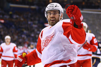 ST. LOUIS, MO - DECEMBER 23: Henrik Zetterberg #40 of the Detroit Red Wings celebrates a goal against the St. Louis Blues at the Scottrade Center on December 23, 2010 in St. Louis, Missouri.  (Photo by Dilip Vishwanat/Getty Images)