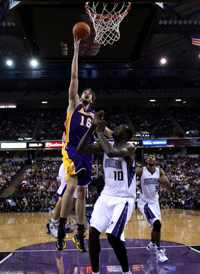 SACRAMENTO, CA - NOVEMBER 03:  Pau Gasol #16 of the Los Angeles Lakers shoots the ball over Samuel Dalembert #10 of the Sacramento Kings at ARCO Arena on November 3, 2010 in Sacramento, California.  NOTE TO USER: User expressly acknowledges and agrees tha