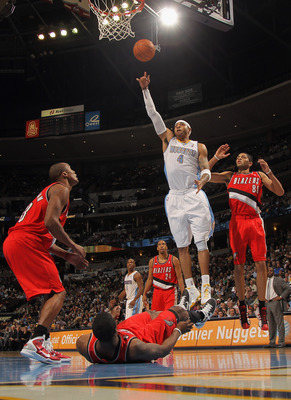 DENVER - DECEMBER 28:  Kenyon Martin #4 of the Denver Nuggets puts up a shot against Dante Cunningham #33, Wesley Matthew #2 (on floor), Nicolas Batum #88 and Andre Miller #24 of the Portland Trail Blazers at Pepsi Center on December 28, 2010 in Denver, C