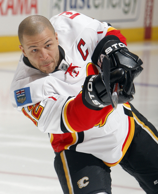 TORONTO, CANADA - JANUARY 15:  Jarome Iginla #12 of the Calgary Flames shoots during warmup before game action against the Toronto Maple Leafs at the Air Canada Centre January 15, 2011 in Toronto, Ontario, Canada. (Photo by Abelimages/Getty Images)