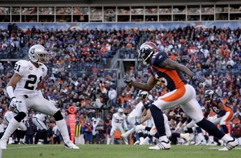 DENVER - NOVEMBER 23:  Wide receiver Brandon Marshall #15 of the Denver Broncos leaves the line of scrimmage against cornerback Nnamdi Asomgha #21 of the Oakland Raiders during week 12 NFL action at Invesco Field at Mile High on November 23, 2008 in Denve