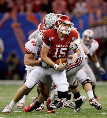 NEW ORLEANS, LA - JANUARY 04:  Quarterback Ryan Mallett #15 of the Arkansas Razorbacks is sacked by Cameron Heyward #97 and Dexter Larimore #72 of the Ohio State Buckeyes in the fourth quarter during the Allstate Sugar Bowl at the Louisiana Superdome on J