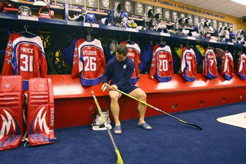 MONTREAL - JANUARY 25:  Martin St. Louis of the  Eastern Conference All-Stars gets prepared in the locker room before the 2009 NHL All-Star game at the Bell Centre on January 25, 2009 in Montreal, Canada. (Photo by Bruce Bennett/Getty Images)
