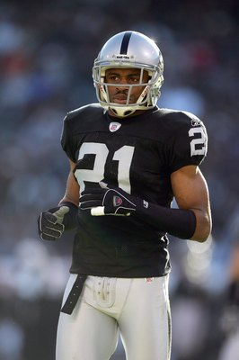 OAKLAND, CA - DECEMBER 17: Nnamdi Asomugha #21 of the Oakland Raiders jogs on the field during an NFL game against the St. Louis Rams at McAfee Coliseum December 17, 2006 in Oakland, California. (Photo by Jed Jacobsohn/Getty Images)