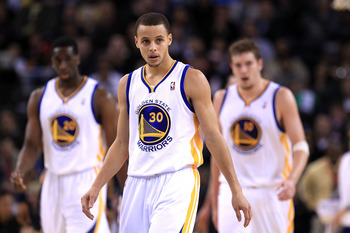 OAKLAND, CA - JANUARY 19:  Stephen Curry #30 of the Golden State Warriors walks back down the court after the Warriors were called for a offensive foul during their game against the Indiana Pacers at Oracle Arena on January 19, 2011 in Oakland, California