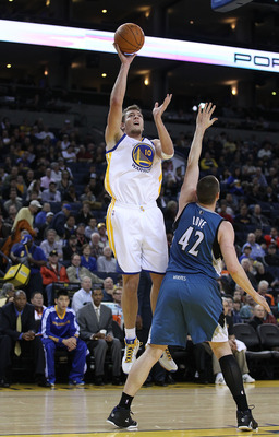 OAKLAND, CA - DECEMBER 14:  David Lee #10 of the Golden State Warriors in action against the Minnesota Timberwolves at Oracle Arena on December 14, 2010 in Oakland, California.  NOTE TO USER: User expressly acknowledges and agrees that, by downloading and