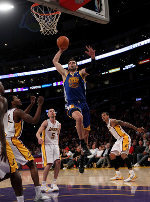 LOS ANGELES - NOVEMBER 21:  Vladimir Radmanovic #77 of the Golden State Warriors goes up for a dunk against the Los Angeles Lakers at Staples Center on November 21, 2010 in Los Angeles, California.   The Lakers won 117-89. NOTE TO USER: User expressly ack