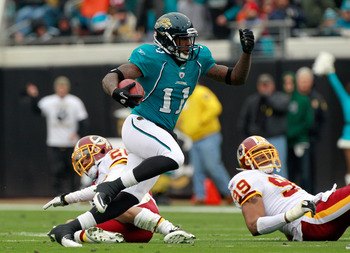 JACKSONVILLE, FL - DECEMBER 26:  Mike Sims-Walker #11 of the Jacksonville Jaguars runs after making a reception during the game against the Washington Redskins at EverBank Field on December 26, 2010 in Jacksonville, Florida.  (Photo by Sam Greenwood/Getty