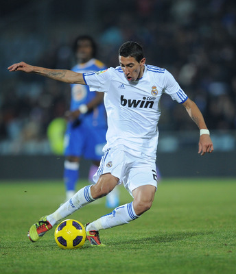 GETAFE, SPAIN - JANUARY 03:  Angel di Maria of Real Madrid in action during the La Liga match between Getafe and Real Madrid at Coliseum Alfonso Perez stadium on January 3, 2011 in Getafe, Spain.  (Photo by Denis Doyle/Getty Images)