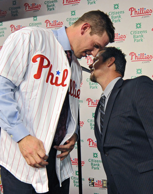 PHILADELPHIA - DECEMBER 15: Pitcher Cliff Lee #33 of the Philadelphia Phillies talks with former pitcher Mitch Williams after being introduced to the media during a press conference at Citizens Bank Park on December 15, 2010 in Philadelphia, Pennsylvania.