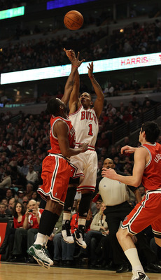 CHICAGO, IL - DECEMBER 28: Derrick Rose #1 of the Chicago Bulls puts up a shot against Keyon Dooling #55 and Ersan Ilyasova #7 of the Milwaukee Bucks at the United Center on December 28, 2010 in Chicago, Illinois. The Bulls defeated the Bucks 90-77. NOTE