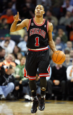CHARLOTTE, NC - JANUARY 12:  Derrick Rose #1 of the Chicago Bulls calls a play against the Charlotte Bobcats during their game at Time Warner Cable Arena on January 12, 2011 in Charlotte, North Carolina. NOTE TO USER: User expressly acknowledges and agree