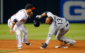 ATLANTA - JUNE 17:  Martin Prado #14 of the Atlanta Braves tags out a sliding Carl Crawford #13 of the Tampa Bay Rays at second base at Turner Field on June 17, 2010 in Atlanta, Georgia.  (Photo by Kevin C. Cox/Getty Images)