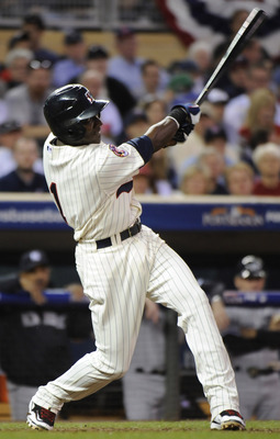 MINNEAPOLIS, MN - OCTOBER 7: Orlando Hudson #1 of the Minnesota Twins hits a solo home run in the sixth inning during game two of the ALDS game against the New York Yankees on October 7, 2010 at Target Field in Minneapolis, Minnesota.  (Photo by Hannah Fo