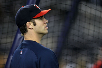 NEW YORK - OCTOBER 09:  Joe Mauer #7 of the Minnesota Twins looks on during batting practice against the New York Yankees during Game Three of the ALDS part of the 2010 MLB Playoffs at Yankee Stadium on October 9, 2010 in the Bronx borough of New York Cit