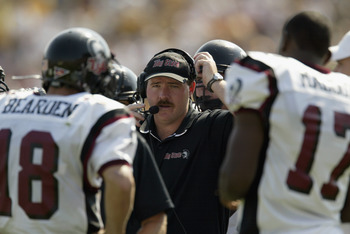 COLUMBIA, MO - SEPTEMBER 28:  Offensive line coach Greg Adkins of the Troy State Trojans stands on the sideline during the NCAA football game against the Missouri Tigers on September 28, 2002 at Faurot Field in Columbia, Missouri.  Missouri won 44-7. (Pho