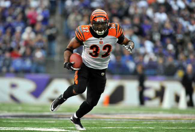 BALTIMORE, MD - JANUARY 2:  Cedric Benson #32 of the Cincinnati Bengals runs the ball against the Baltimore Ravens at M&T Bank Stadium on January 2, 2011 in Baltimore, Maryland. The Ravens defeated the Bengals 13-6. (Photo by Larry French/Getty Images)