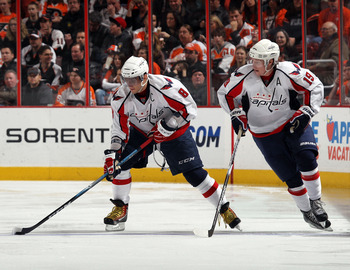 PHILADELPHIA, PA - JANUARY 18: Alex Ovechkin #8 and Nicklas Backstrom #19 of the Washington skate against the Philadelphia Flyers at the Wells Fargo Center on January 18, 2011 in Philadelphia, Pennsylvania. (Photo by Bruce Bennett/Getty Images)