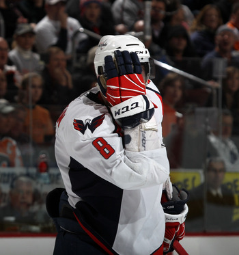 PHILADELPHIA, PA - JANUARY 18: Alex Ovechkin #8 of the Washington Capitals reacts after being hit in the head during the game against the Philadelphia Flyers at the Wells Fargo Center on January 18, 2011 in Philadelphia, Pennsylvania. (Photo by Bruce Benn