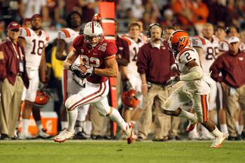 MIAMI, FL - JANUARY 03:  Coby Fleener #82 of the Stanford Cardinal catches a 58-yard touchdown in the fourth quarter against Davon Morgan #2 of the Virginia Tech Hokies during the 2011 Discover Orange Bowl at Sun Life Stadium on January 3, 2011 in Miami,