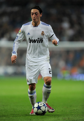 MADRID, SPAIN - JANUARY 13:  Mesut Ozil of Real Madrid controls the ball during the quarter-final Copa del Rey first leg match between Real Madrid and Atletico Madrid at Estadio Santiago Bernabeu on January 13, 2011 in Madrid, Spain.  (Photo by Jasper Jui