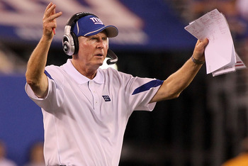 EAST RUTHERFORD, NJ - SEPTEMBER 02:  Head coach Tom Coughlin of the New York Giants reacts during the game against the New England Patriots on September 2, 2010 at the New Meadowlands Stadium in East Rutherford, New Jersey. The Giants defeated the Patriot