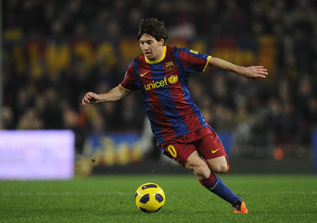 BARCELONA, SPAIN - JANUARY 16:  Lionel Messi of FC Barcelona runs with the ball during the La Liga match between FC Barcelona and Malaga at Nou Camp on January 16, 2011 in Barcelona, Spain. Barcelona won 4-1.  (Photo by David Ramos/Getty Images)